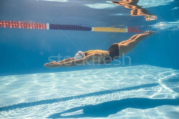 пловец ползать стиль подводного красивая женщина Бассейн Сток-фото © bezikus