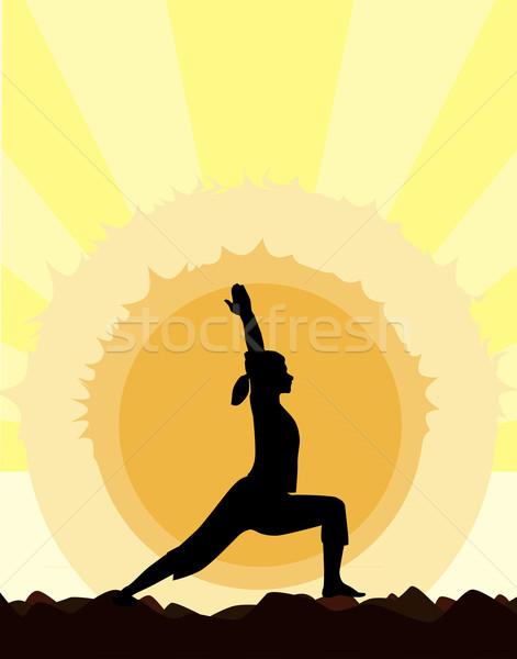 Yoga Warrior Pose Stock photo © Bigalbaloo