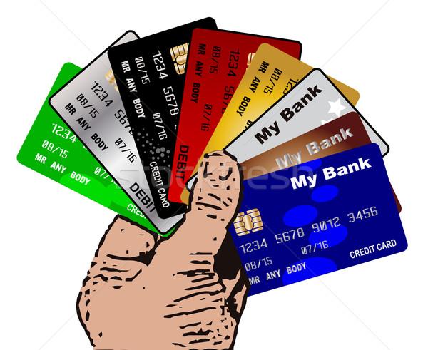 Crédito débito tarjetas mano colección Foto stock © Bigalbaloo