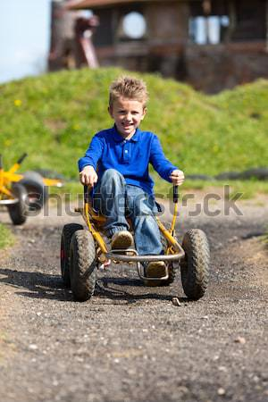 Stock photo: Boy driving moon buggy