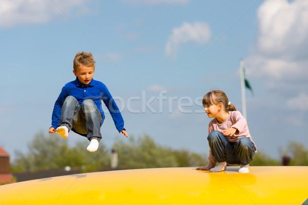 Jumping ragazzi estate divertimento ragazzo Foto d'archivio © bigandt