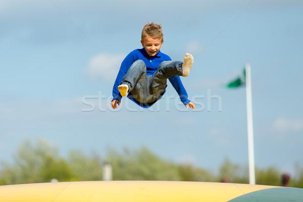 Jumping ragazzo up giù bambini estate Foto d'archivio © bigandt