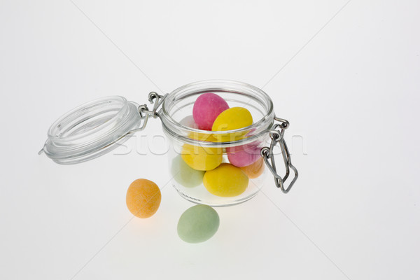 Colored Chocolate Eggs in Glass Jar Stock photo © bigandt