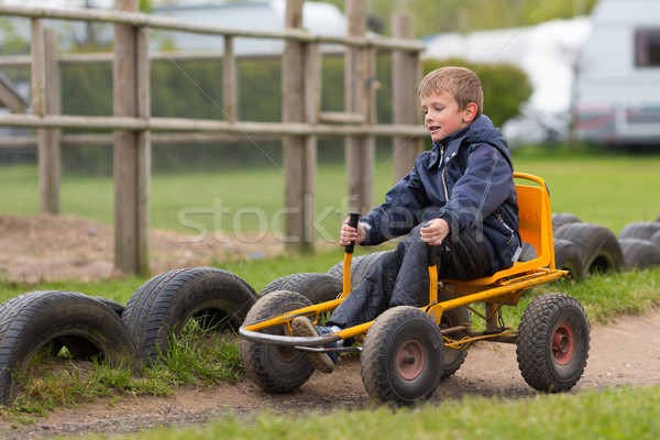 Young boy driving buggy cart Stock photo © bigandt
