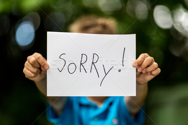 Boy with Sorry sign Stock photo © bigandt