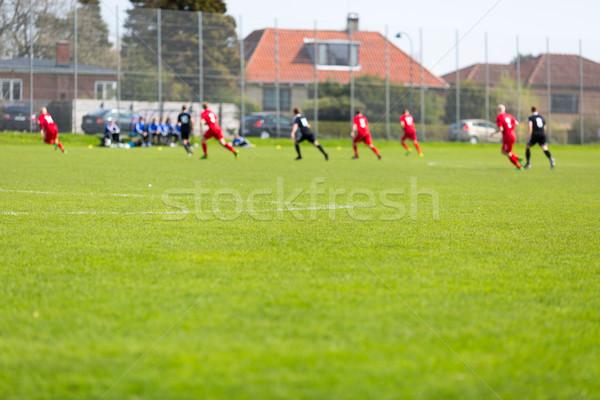 Amateur fútbol partido verde borroso Foto stock © bigandt