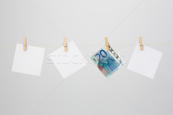 Three White Notes and a Twenty Euro Banknote Stock photo © bigandt