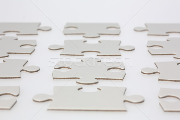 Rows of Jigsaw Puzzle Pieces Stock photo © bigandt