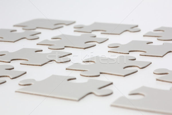 Close-up of White Jigsaw Puzzle Pieces Stock photo © bigandt