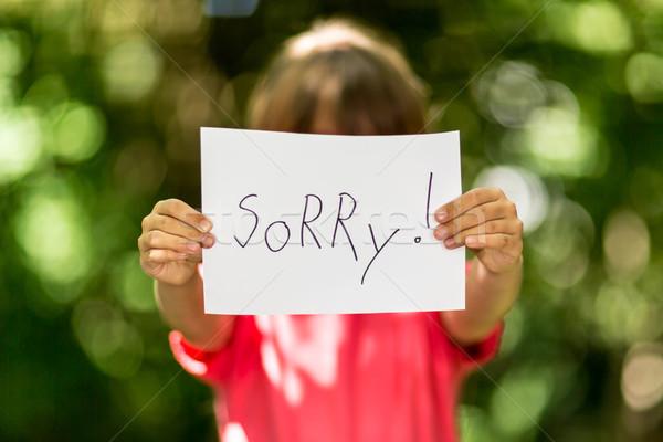 Girl with Sorry sign Stock photo © bigandt
