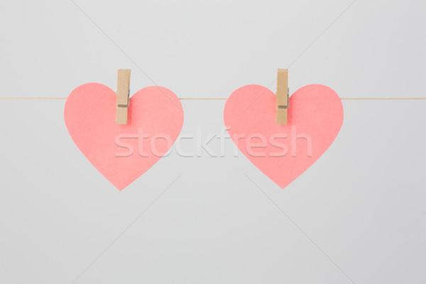 Twee merkt roze stukken papier bevestigd Stockfoto © bigandt