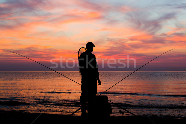 Fishing at dawn Stock photo © bigandt
