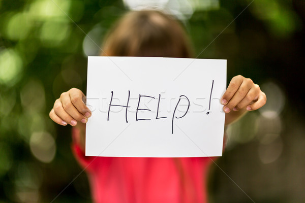 Girl with Help sign Stock photo © bigandt