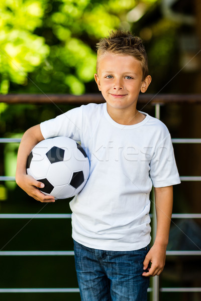 Boy with soccer ball Stock photo © bigandt