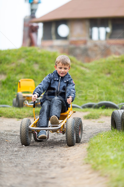 Caucasian boy driving buggy cart Stock photo © bigandt