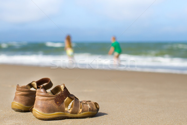Kid sandals with blurred boy and girl Stock photo © bigandt