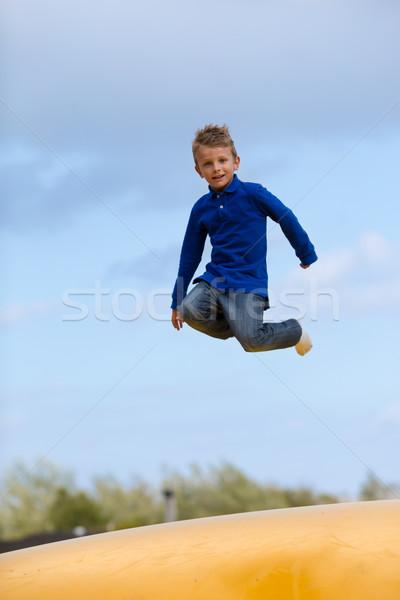 Jumping ragazzo up giù bambini ragazzi Foto d'archivio © bigandt
