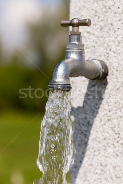 Water flowing from faucet Stock photo © bigandt