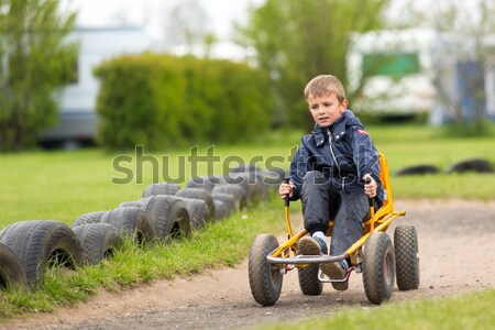 Girl driving buggy cart Stock photo © bigandt
