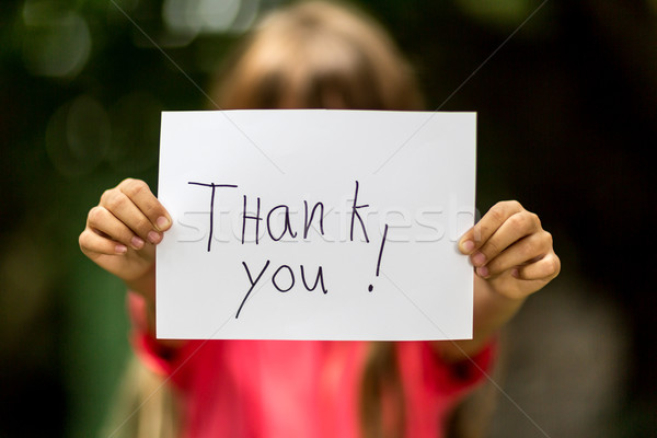 Girl with Thank You sign Stock photo © bigandt