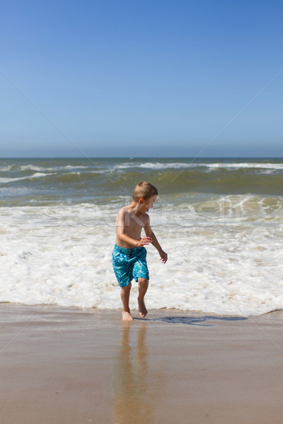 Boy having fun at beach Stock photo © bigandt