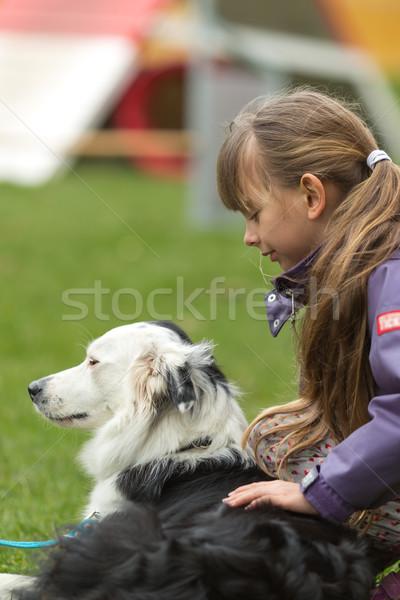 Girl patting dog Stock photo © bigandt