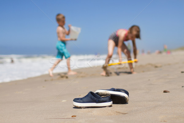Kids slippers lying on the beach Stock photo © bigandt