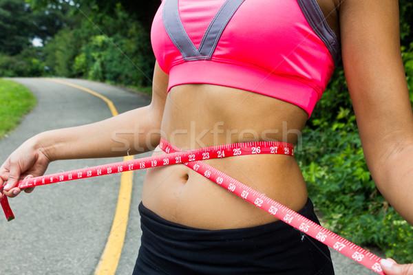 Waist measurement on a fit woman Stock photo © bigjohn36