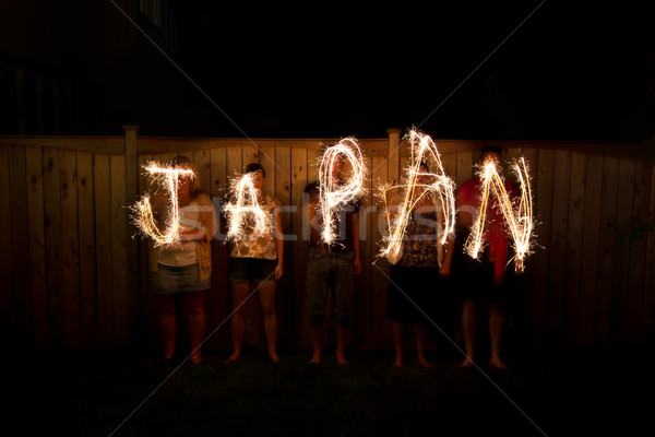 The word Japan in sparklers time lapse photography Stock photo © bigjohn36