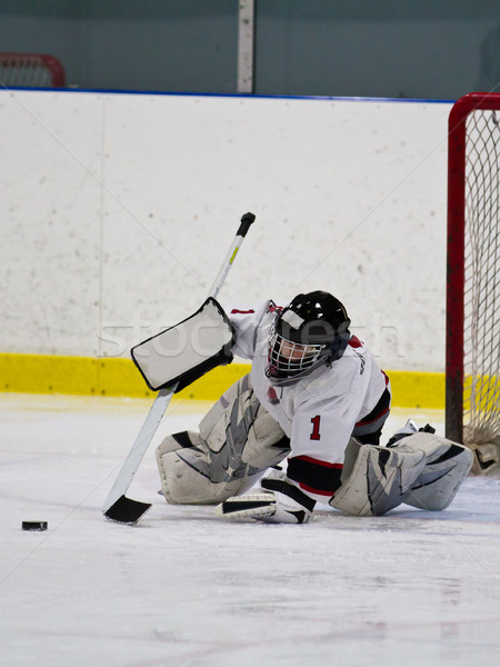 Young ice hockey goaltender making a save Stock photo © bigjohn36