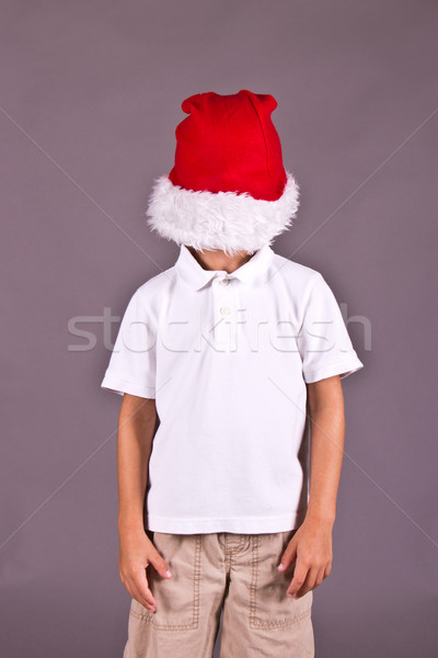 Boy being silly with Santa hat during Christmas Stock photo © bigjohn36