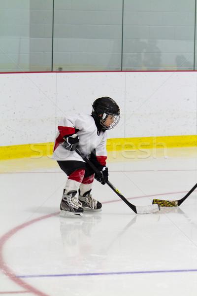 Kicsi fiú játszik jégkorong sport jókedv Stock fotó © bigjohn36