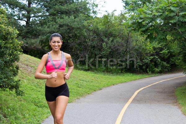 улыбаясь работает фитнес девушки улыбка Сток-фото © bigjohn36