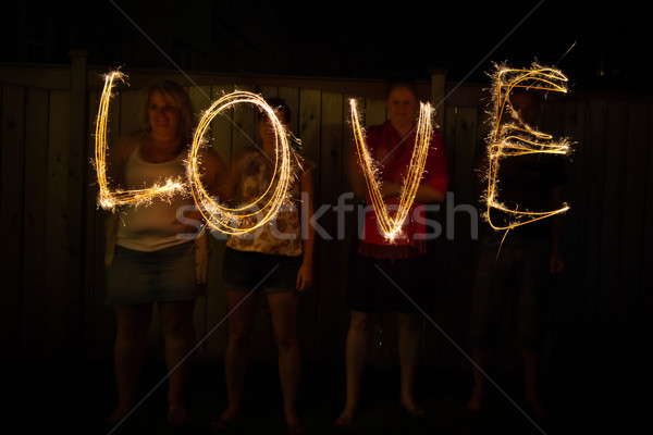 The word Love in sparklers time lapse photography Stock photo © bigjohn36