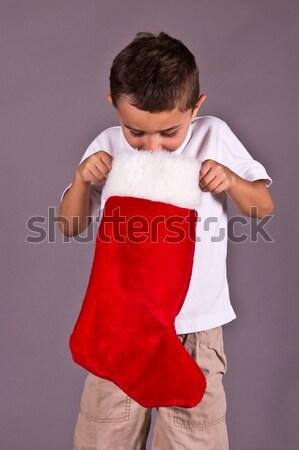 Kicsi fiú néz karácsony harisnya tél Stock fotó © bigjohn36