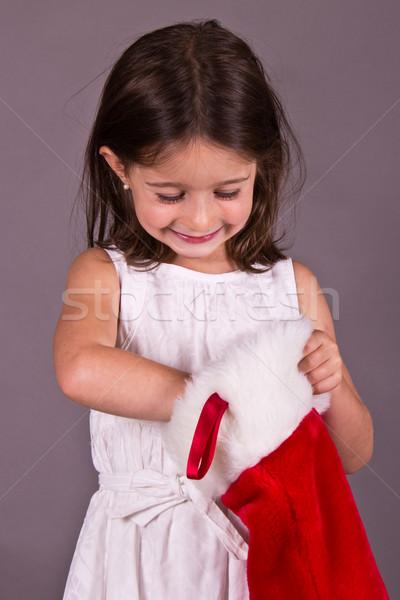 Kislány ajándék karácsony harisnya lány tél Stock fotó © bigjohn36