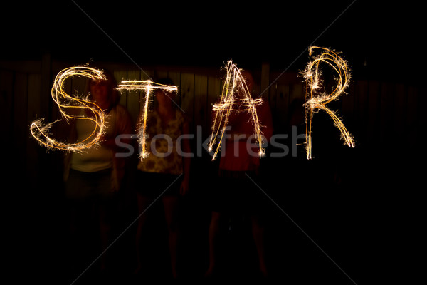 The word Star in sparklers time lapse photography Stock photo © bigjohn36