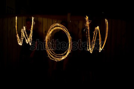The word Wow in sparklers time lapse photography Stock photo © bigjohn36