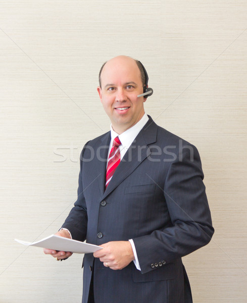 Business man with headset and document Stock photo © bigjohn36