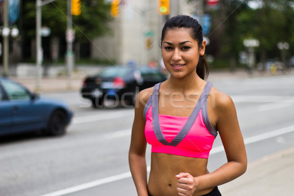 Fit young woman running on a busy city street Stock photo © bigjohn36