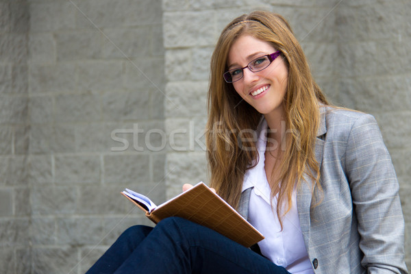 Smart young young reading her journal Stock photo © bigjohn36