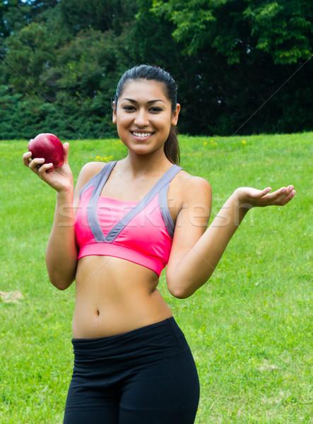 フィット 若い女性 リンゴ 公園 少女 笑顔 ストックフォト © bigjohn36