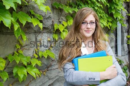 Glimlachende vrouw tijdschrift mooi meisje schrijven vrouw boek Stockfoto © bigjohn36