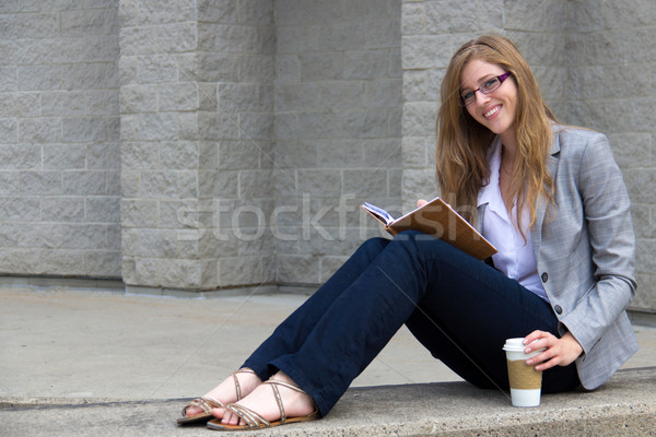 Confident young woman reading her journal Stock photo © bigjohn36