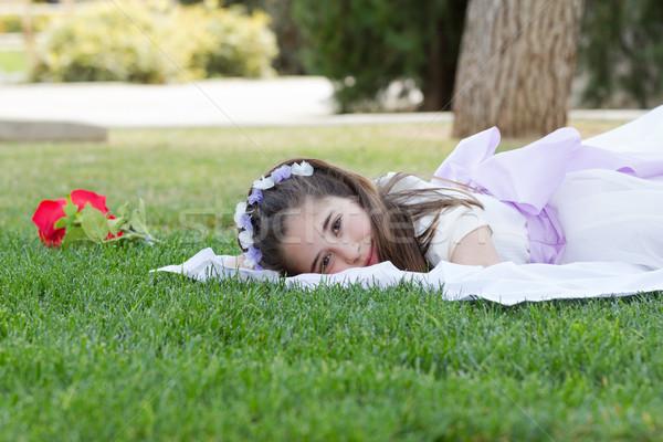 Młoda dziewczyna pierwsza komunia ogród pierwszy święty Zdjęcia stock © BigKnell