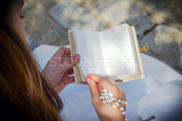 Young girl reading blank prayer book Stock photo © BigKnell