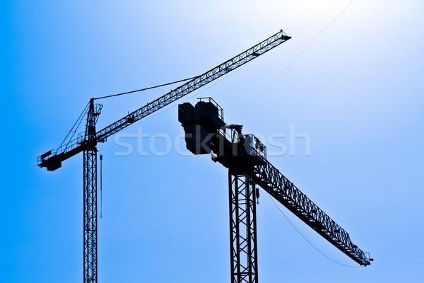 Sylwetki sylwetka dwa działalności budowy metal Zdjęcia stock © BigKnell