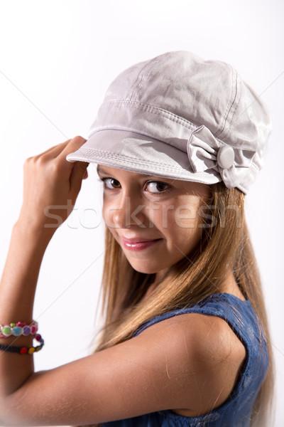 Młoda dziewczyna stwarzające hat cute dziewczyna biały Zdjęcia stock © BigKnell