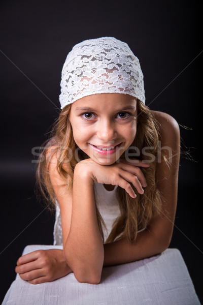 Young girl with white cap smiling Stock photo © BigKnell