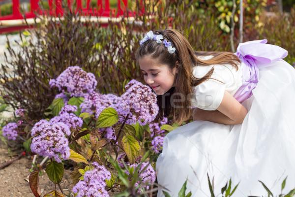Genç kız çiçekler ilk cemaat Stok fotoğraf © BigKnell
